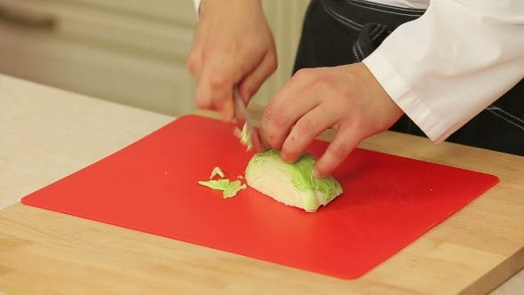 Thumbnail for Chef Cutting Green Cabbage