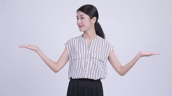 Thumbnail for Happy Beautiful Asian Businesswoman Comparing Something