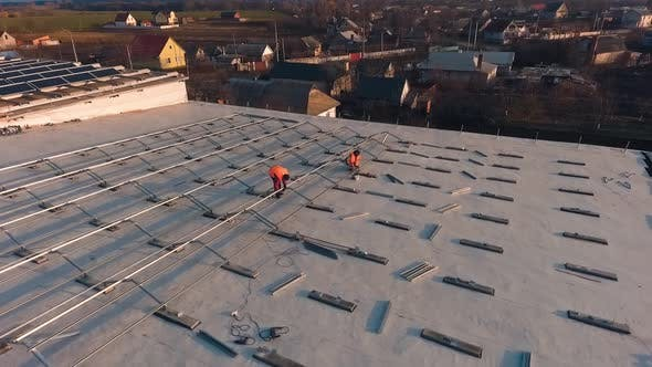 Thumbnail for Workers on Roof Installing Solar Panels