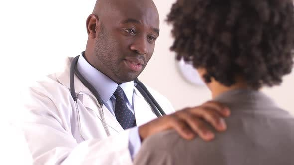 Over the shoulder shot of doctor talking to patient