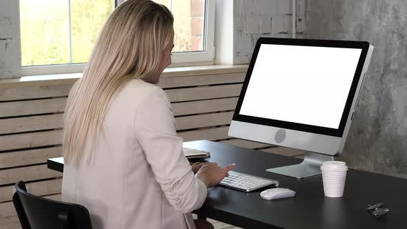 Thumbnail for Business Woman in Dress Sitting on Workplace Near the Window and Using Computer in Office