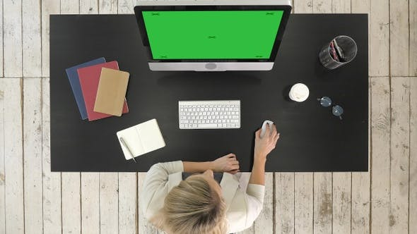 Cover Image for Businesswoman Working At Computer In Office. Green Screen