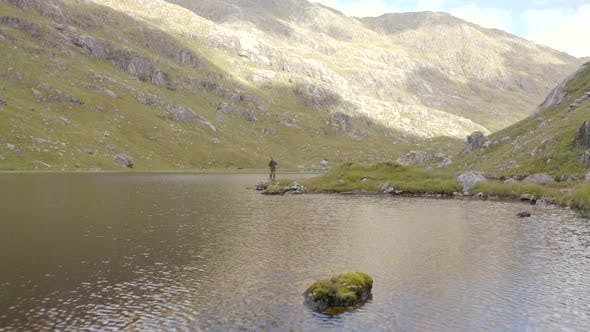 Fly Fishing in a Mountain Lake Surrounded By Beautiful Landscape