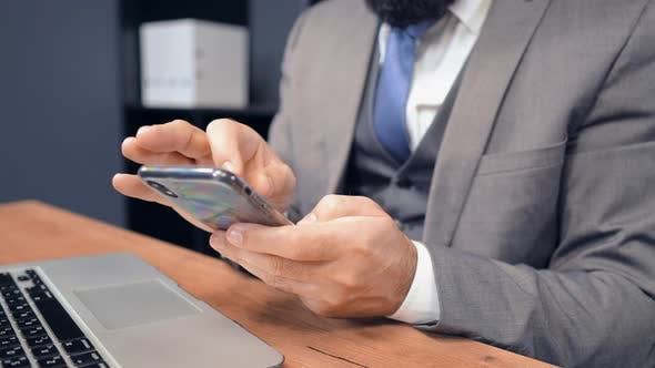 Thumbnail for Close Up Middle Aged Businessman Using Smartphone in Office