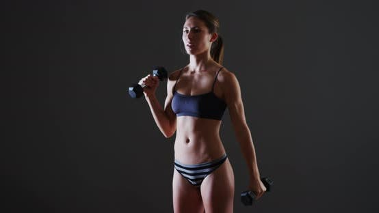 Thumbnail for Fit mixed race woman lifting weights