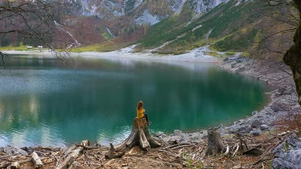 Thumbnail for Girl Resting On A Shore Of Mountain Lake 2
