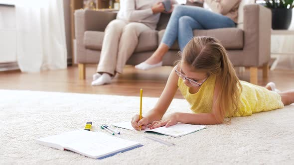 Thumbnail for Student Girl with Notebook Lying on Floor at Home
