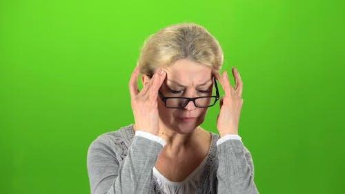 Woman Suffers From a Headache. Green Screen