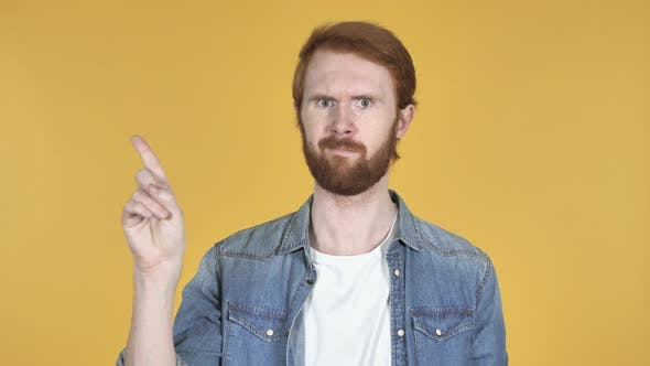 Thumbnail for Redhead Man Waving Finger To Refuse, Yellow Background