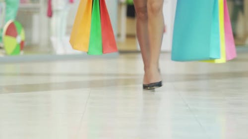 Elegant Woman Legs in Black Highheels Walking in Shopping Mall