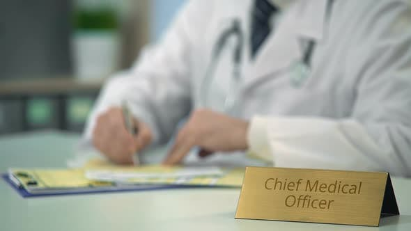 Chief Medical Officer Completing Report, Prescribing Medication in Clinic