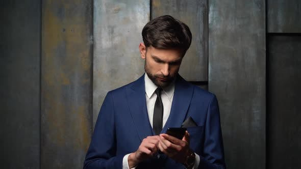 Thumbnail for Young Handsome Stylish Businessman Using Smartphone, 4x Slow Motion