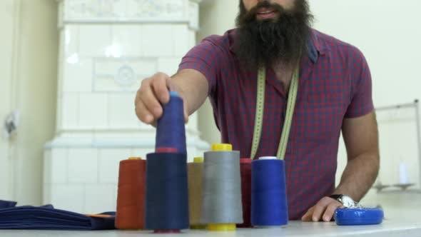 Thumbnail for Tailor choosing thread