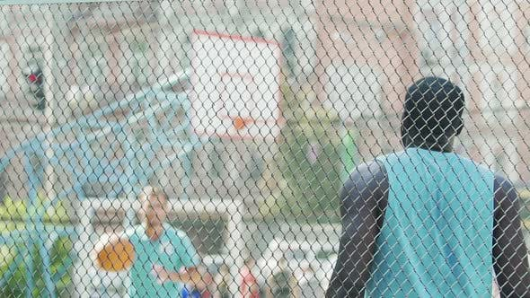 Thumbnail for Two Active Men Passing Ball to Each Other, Training on Basketball Court, Slow-Mo