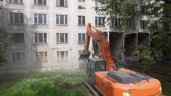 An Excavator Destroys the Building with Its Bucket