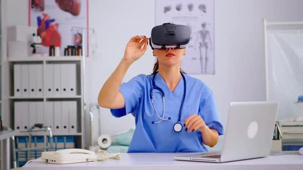 Health Physician Using Medical Inovation Wearing Virtual Reality