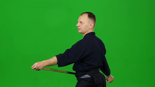 Thumbnail for Masculine Kendo Warrior Practicing Martial Art with the Bamboo Bokken on Green Screen. Slow Motion