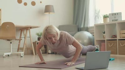 Woman Training at Home with Tutorial