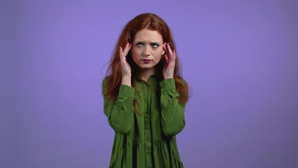 Portrait of Woman Having Headache Violet Studio Portrait
