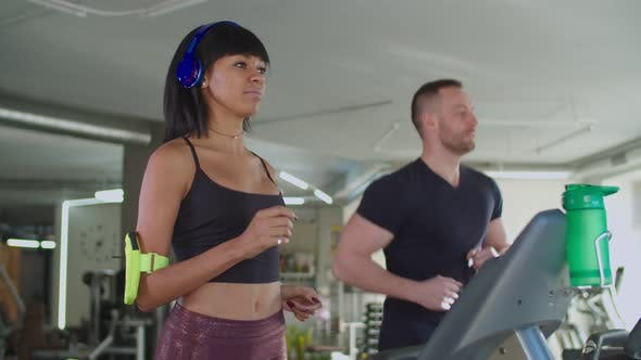Thumbnail for Diverse Fitness People Running on Treadmill at Gym