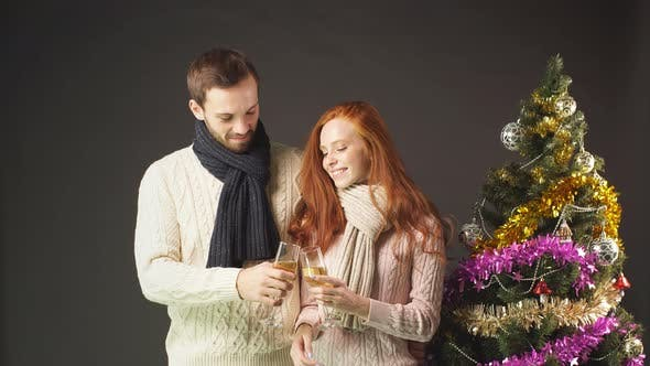 Jolly Man and Woman Champagne Celebration Christmas Lifestyle Luxury