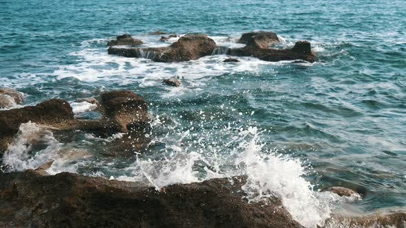 Cover Image for The Black Sea Shore with Boulders and Foamy Waves in Alanya in Summer