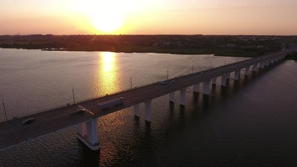Thumbnail for Aerial Shot of Picturesque Bridge Covering the Dnipro at Dreamy Sunset in Summer
