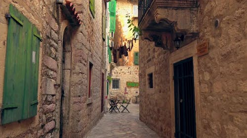 Traveling By Narrow Streets of Ancient Town with Stone Buildings