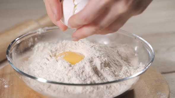 Thumbnail for Slow Motion of Falling Eggs Into Flour Stock. Footage Food. Egg Dropping Into Flour, Slow Motion.