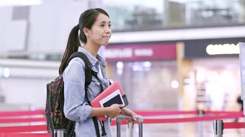 Woman waiting for check in at airport