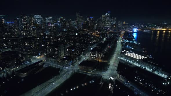 Thumbnail for Flying Over City Waterfront At Night With Tall Buildings