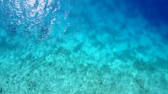 Thumbnail for Tropical drone tourism shot of a white sandy paradise beach and aqua blue water background