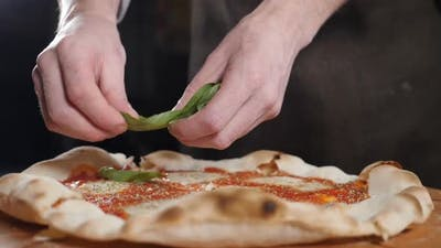 Cooking Traditional Vegetarian Pizza in Italian Pizzeria