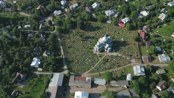 Aerial View of the Church and Cemetery in the Countryside