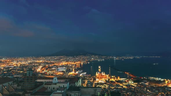 Naples, Italy. 4K Top View Skyline Cityscape In Evening Lighting Day To Night. Volcano Vesuvius