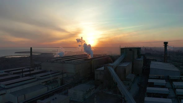 Industrial Zone with White Smoke Is Poured From the Factory Pipe in Contrast To the Sun. Pollution