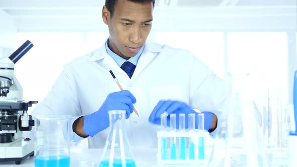 Thumbnail for Scientist Writing Details, Result of Research in Laboratory