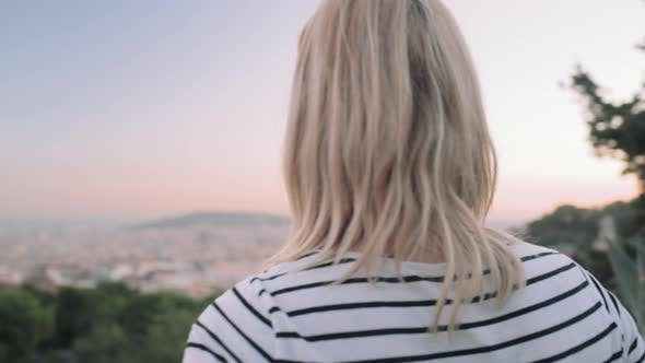 Young adult woman enjoying view of Barcelona