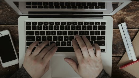 Thumbnail for Businessman Typing On His Laptop On a Wooden Desk Table