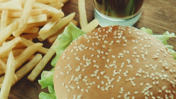 Cover Image for Hamburger a Sandwich And French Fries On a Tray