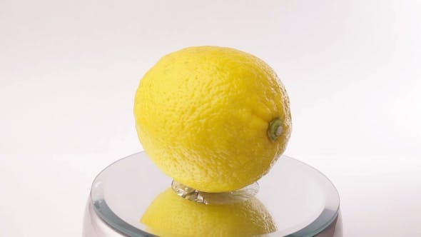 Thumbnail for Yellow Lemon Turning On Itself On a White Background
