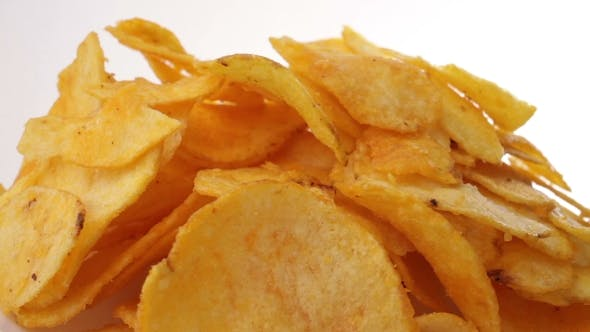 Thumbnail for Potato Chips Heap Rotating Over White Background