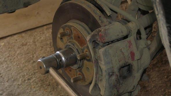 Thumbnail for Mechanic Dismantling Brake Disk Of Car