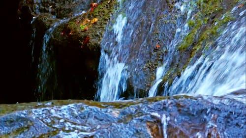 Waterfall Water Flowing Down On Stones