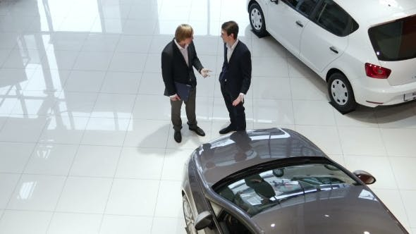Thumbnail for Sales Manager And Customer In Car Showroom