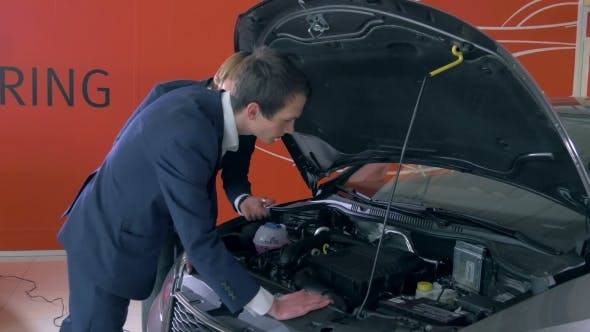 Thumbnail for Customer Inspecting Car Engine