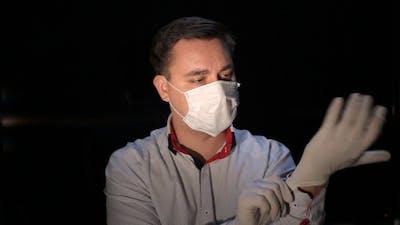 The Man Wears Gloves
