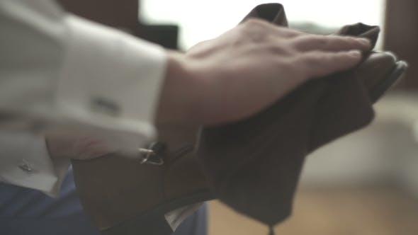 Thumbnail for Man Polishing Brown Leather Shoe