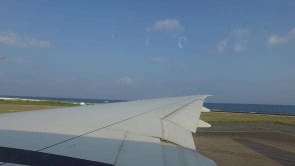 Thumbnail for Wing Of Airplane Gathering Speed On Runway 1