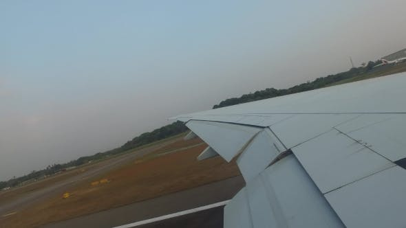 Thumbnail for Wing Of Airplane Gathering Speed On Runway 100
